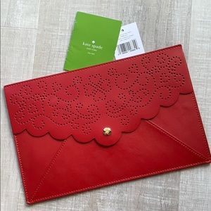 Kate spade laser cut envelope pouch in red.